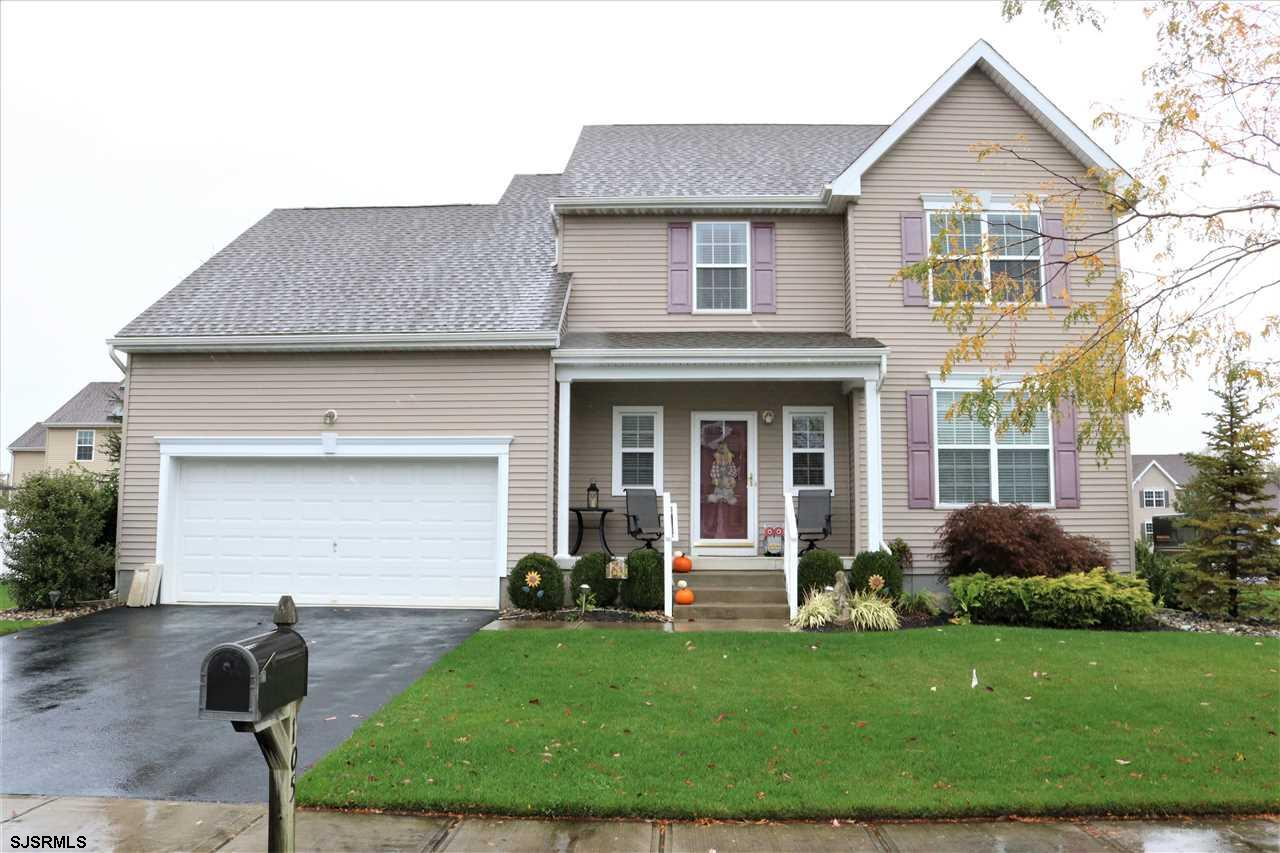 A Home for the Holidays with a cozy fireplace and formal dining room for family gatherings. This 4 bedroom home is like new with plenty of room for storage or expansion in the full basement.  The kitchen has an island, stainless steel appliances and beautiful hardwood floors.  Relax on the big Trex deck overlooking a nicely landscaped yard with a sprinkler system.  The four bedrooms are all a nice size and have ceiling fans as well as the family room.  This tastefully decorated home is one you don't want to miss and is located in a lovely neighborhood.