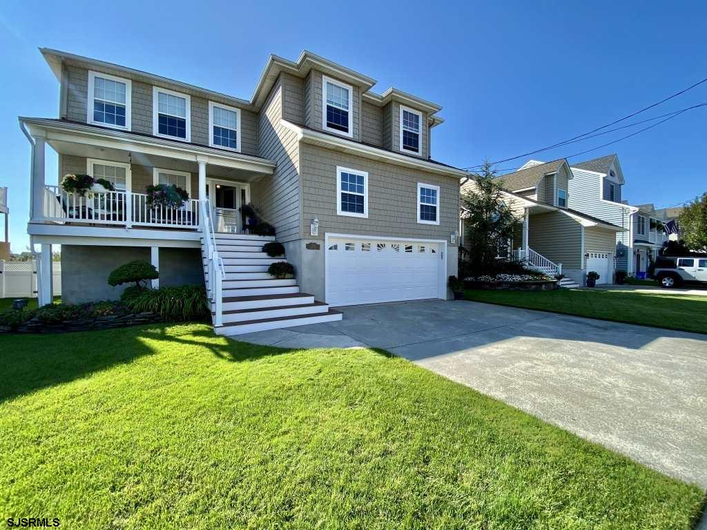 This beautiful home is nestled in Brigantine's finest golf course neighborhood. Enjoy spectacular go