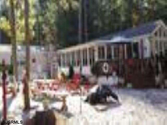 Seasonal Mobile Home with out Land! Welcome to the Egg Harbor River Resort! Make a summer full of memories in this 1 bedroom, 1 bath mobile home, with full-size gas range and oven, microwave, and refrigerator. Relax on the large deck and check out the local wildlife; or enjoy board games in the sunroom with friends. This wooded, seasonal mobile home park features an inground pool, rec hall, playground, common area for socializing and on site laundry facility. Come visit some fantastic forest views with short drives to the beach, shopping, and the Atlantic City nightlife. The season is March 1st to November 1st. No year round residency. Credit and background checks required by park manager.