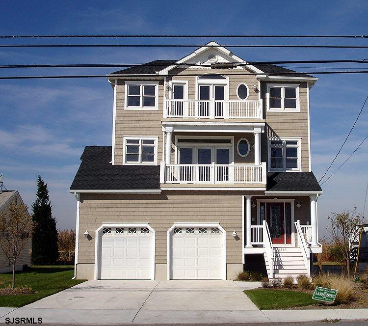 3 story waterfront home with gorgeous bay views.  4 bedrooms, 3.5 baths, elevator, master suite, 2 l