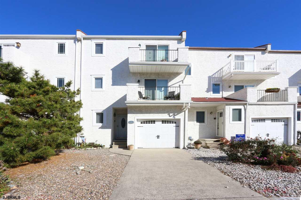 Living the Dream in Brigantine within this Beach-block, remodeled, 3 Story townhouse.  Property feat