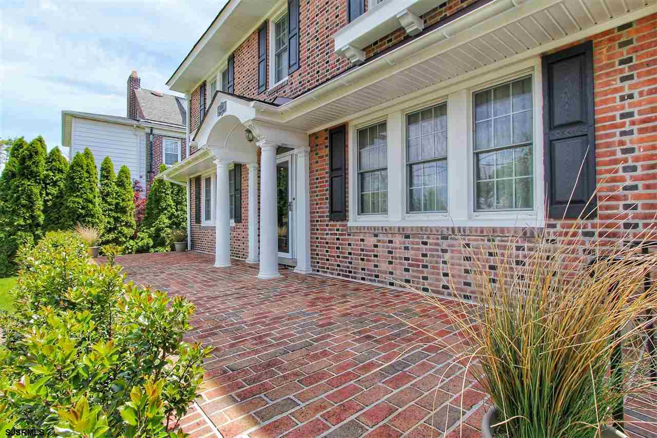 Just 2 blocks to the beach, this stunning renovated and restored 4 bedroom, 2.5 bath brick Colonial