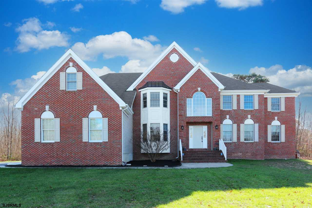 If you are looking for a large stately Brick Front property this is the home for you. Just under 410