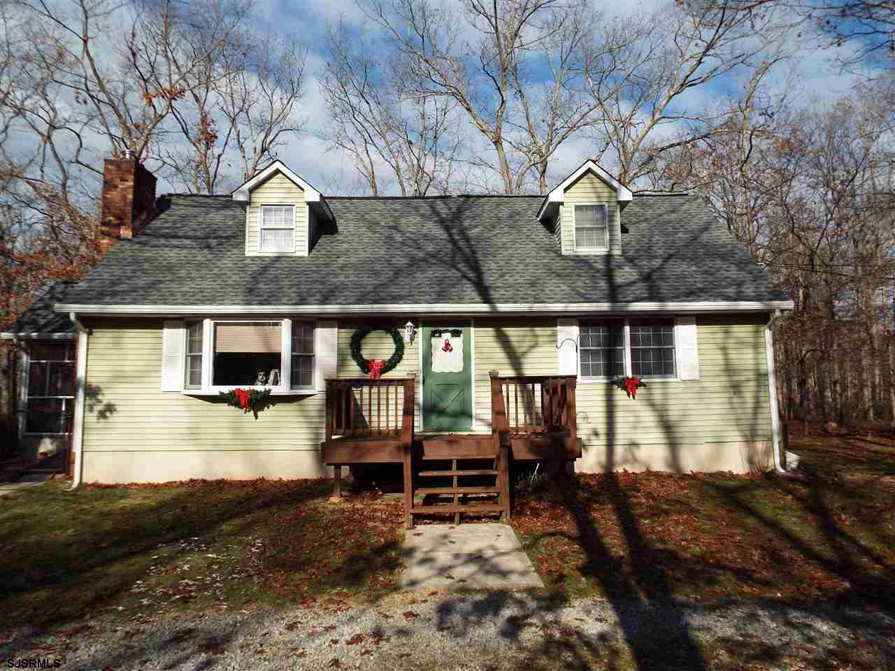 Privacy and social distancing Come naturally on this 6+ acre three bed two bath Cape Cod .Plenty of