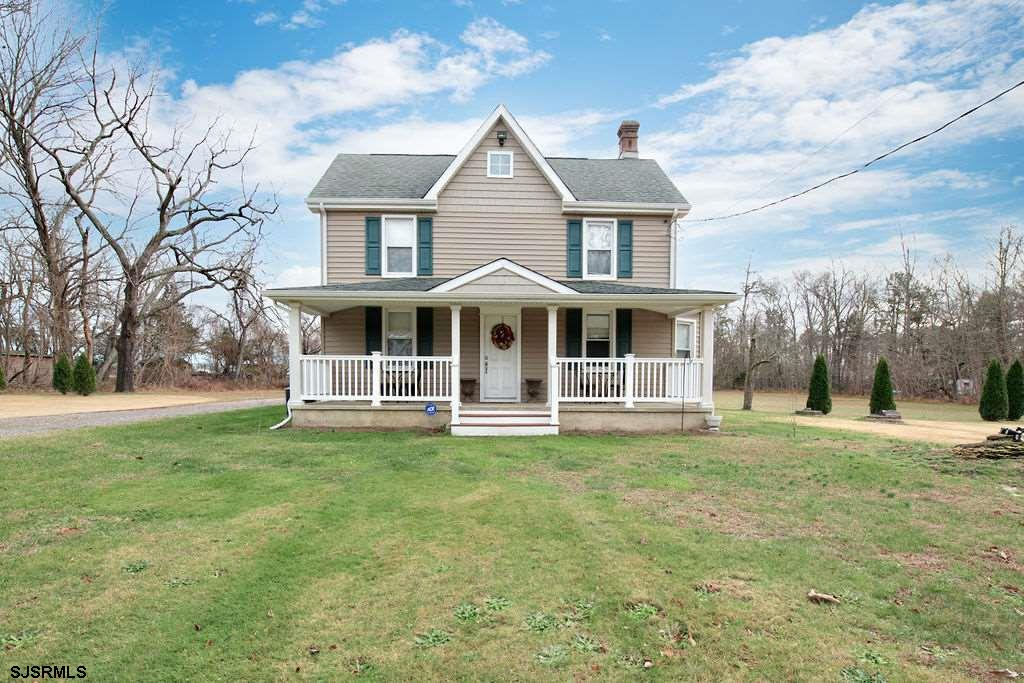 Almost 2 acres of land and a classic 2-story farm-home with modern upgrades that are both cosmetic a