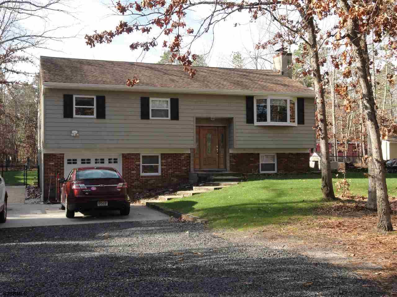 This well maintained Sweetwater home is situated on one peaceful wooded acre and features a private