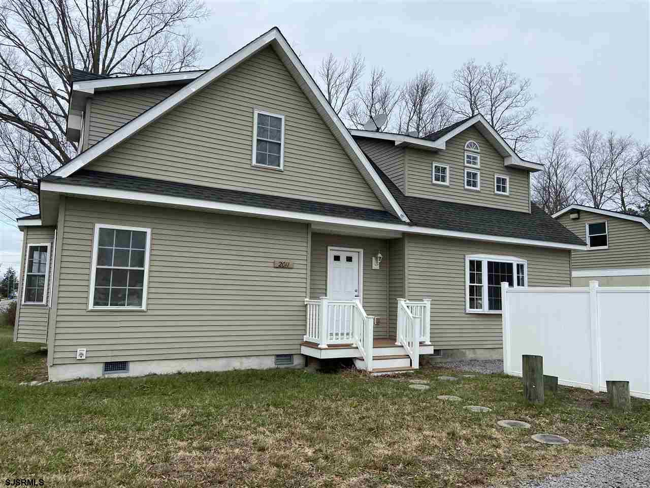 This is the perfect opportunity to own a single family home and a huge detached garage (28'11 X 31'9) in a very desirable location. The property fronts on Route 50. The property would be good for a home business, a tradesman or someone looking to have plenty of storage and room in the garage for work vehicles.This single family 2 story home home consists of a living room that leads into the EIK/dining area. There is a full bath and BD on the 1st floor. Upstairs has another full bath 2/3 generous sized BD's and a laundry room. The backyard is a decent size and fenced in. The garage has a full bath, an office located upstairs (14'0 X 19'7) and a huge loft, (30'10 X 19'7). The entire home has been updated and maintained. You also have multi zo