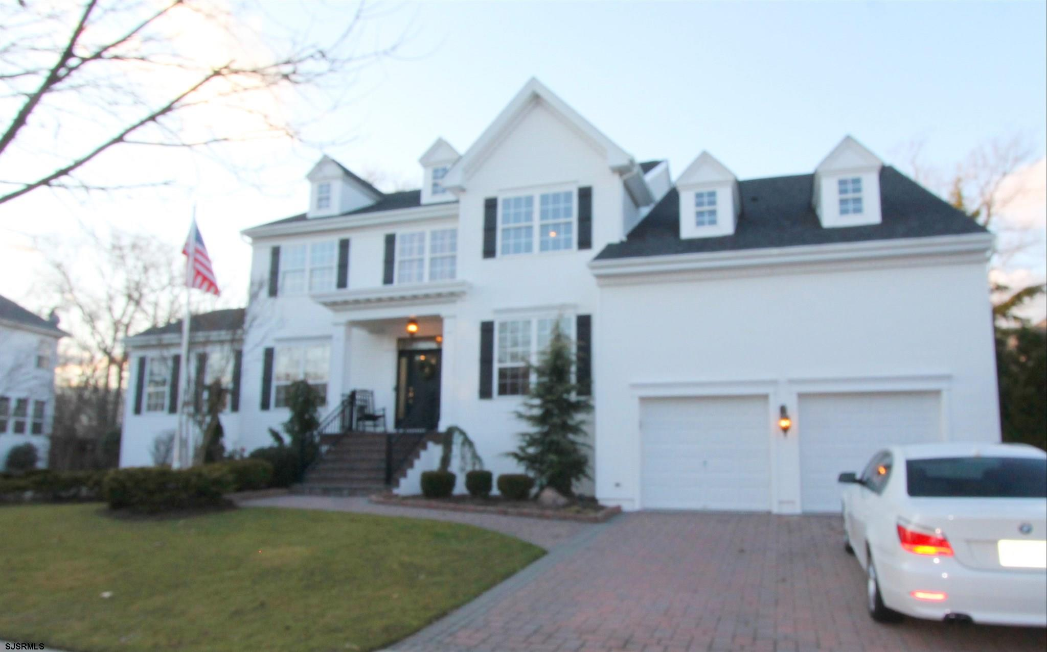 Stately & stunning is this Sutton woods home which backs up to privacy trees! Exterior upgrades & up