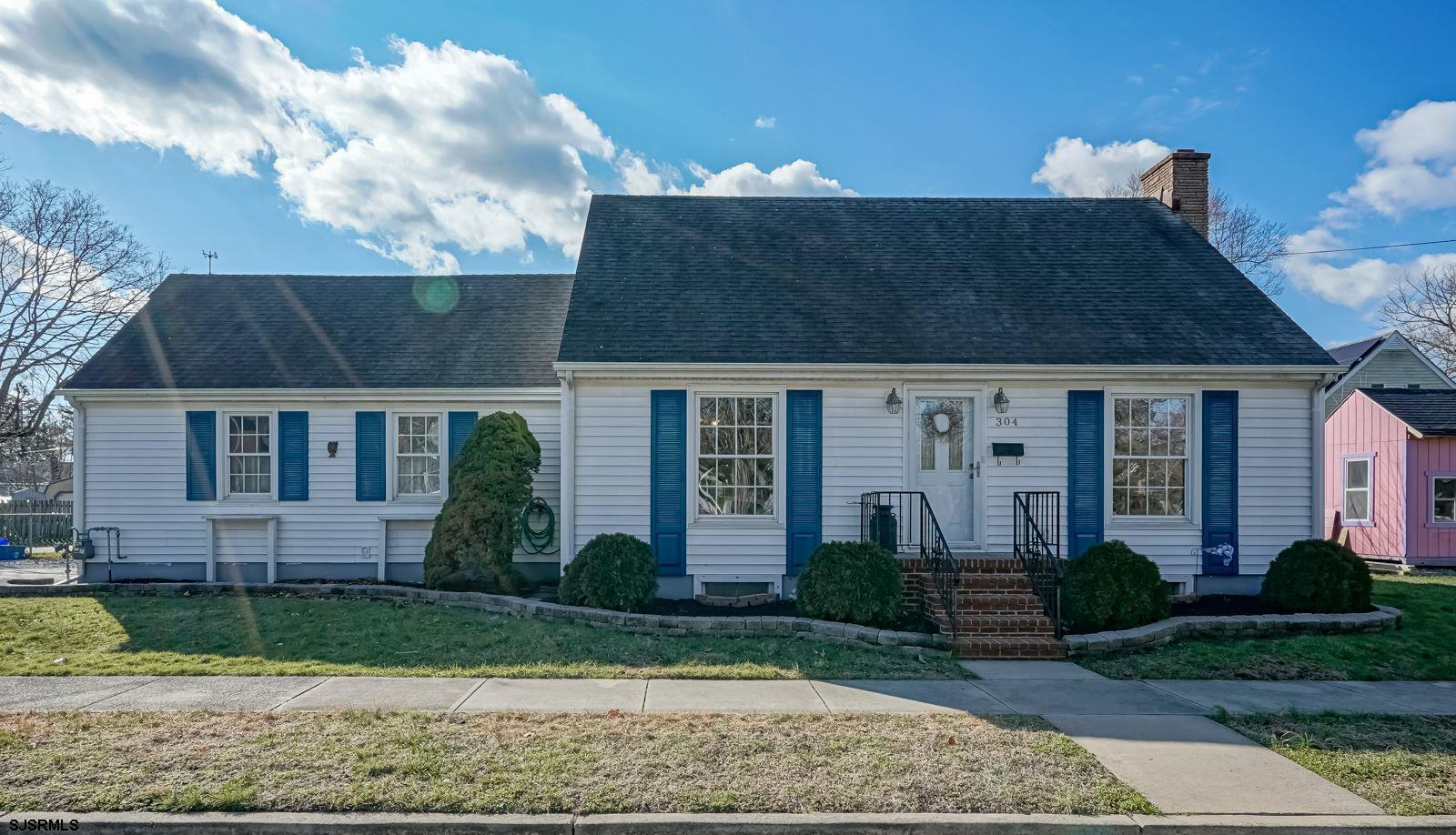Gorgeous Cape Cod on corner lot with full basement and side entry 2 car garage. HW floor throughout
