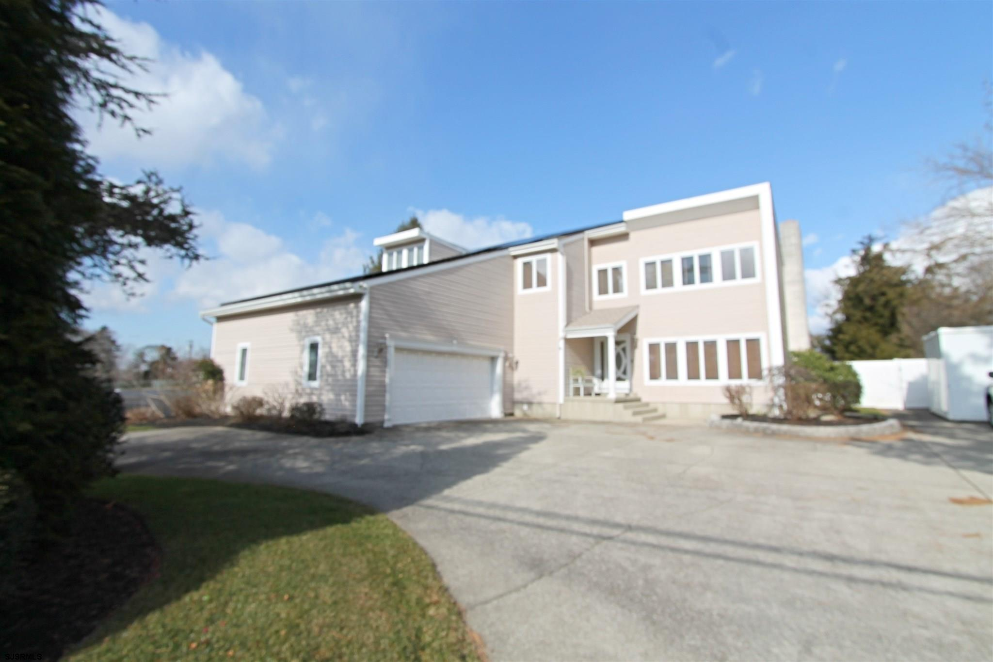 Plenty of off street parking with the Circular drive and 2 car garage! Large family room open to the