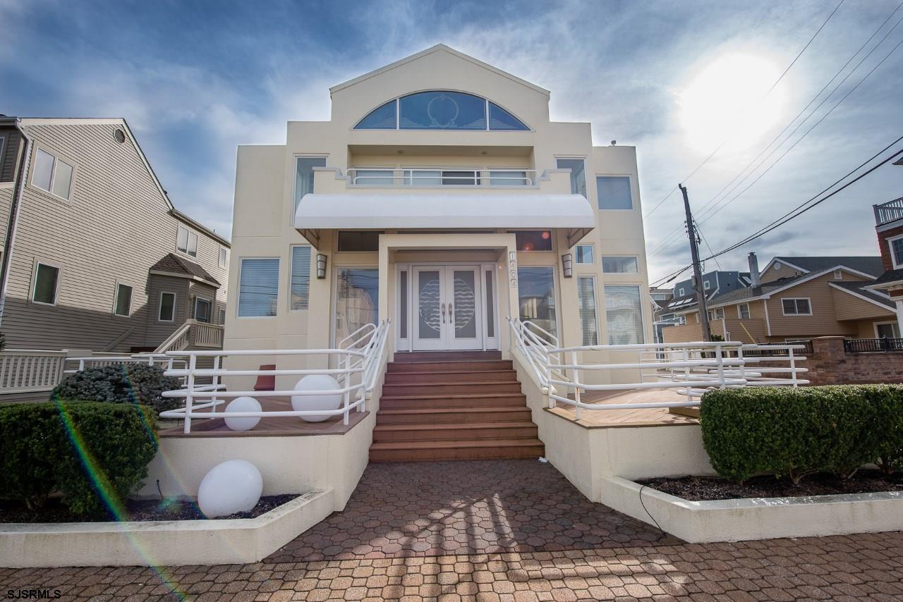 Longport's best beachblock value. Savor bay views and gentle sea breezes in this stunning classic aw