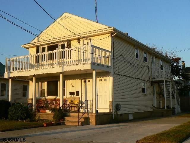 Spacious first floor apartment . 2 large bedrooms, plenty of closet space  , open living- dining room layout , Hardwood floors , Bay views . Front porch . Separate laundry room .