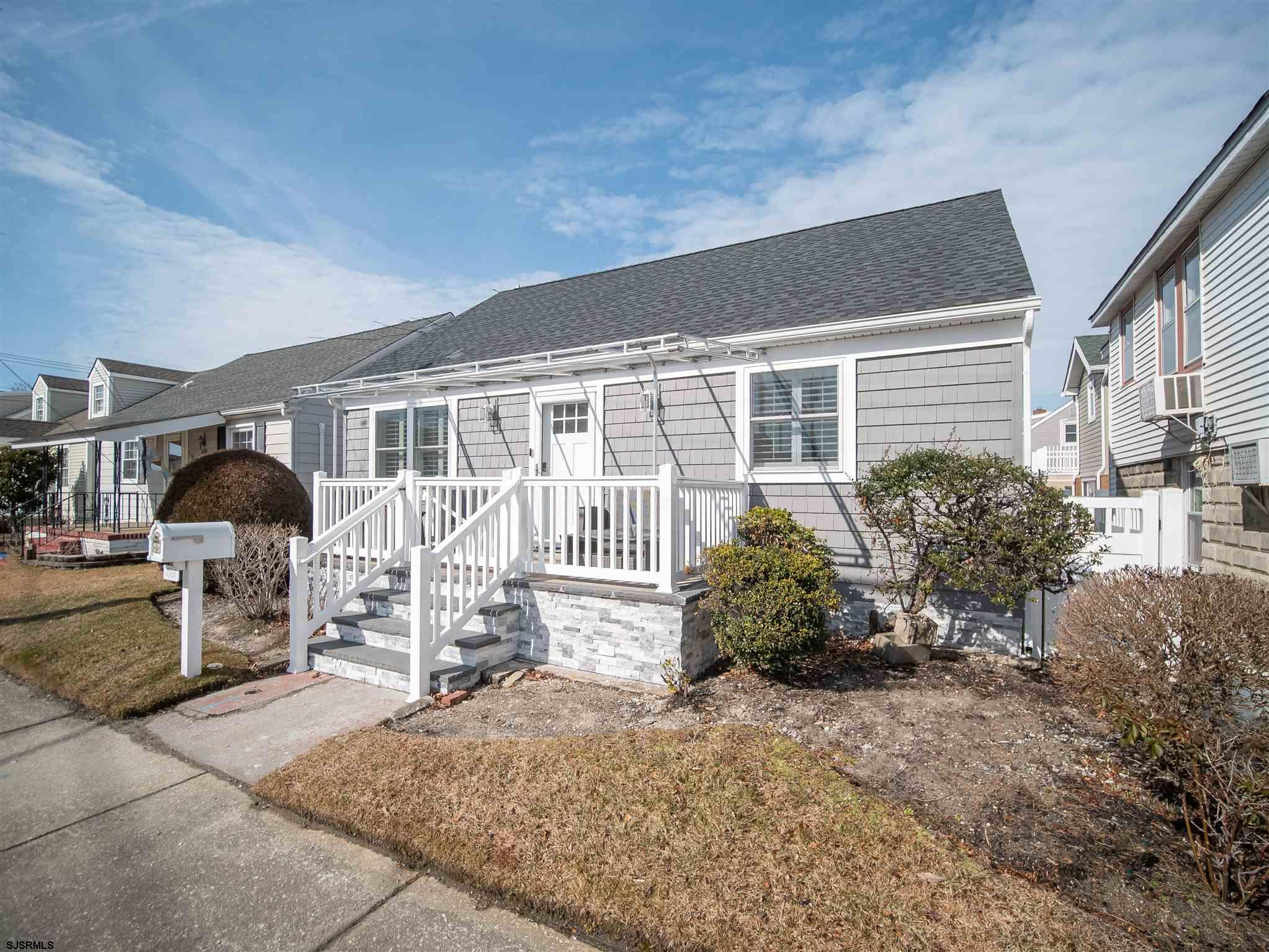 This totally renovated 3 BR 2 BA home makes for the perfect summer escape! Enter into the bright ope
