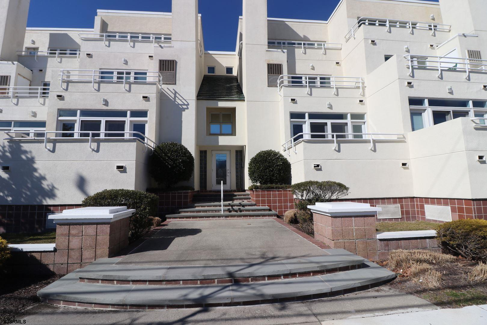 BEACH HOUSE   Bright and cheerful  this large unit faces Atlantic Avenue just a scant block to the b