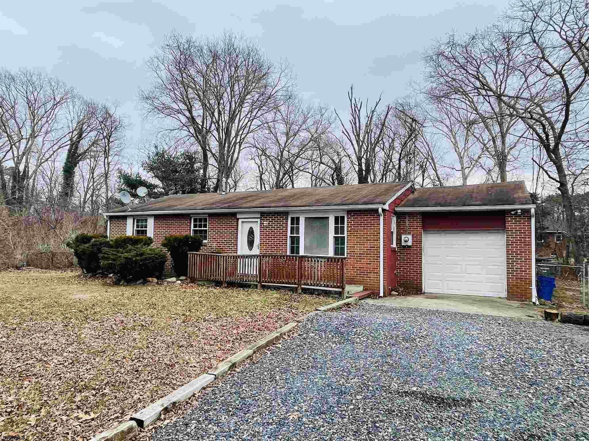 START SMART WITH THIS FABULOUS BRICK FACED RANCHER!  Clean and neat and so close to the Expressway and Garden State Parkway, making for an easy commute to the AC night life, the beaches and boardwalk.  Laminate flooring throughout makes it super easy to maintain.  The bathroom has been updated with a new tub-surround, vanity top and flooring. The formal dining room provides great space for your evening meals or set up a table in the well sized kitchen for a quick bite.  Off of the kitchen is a bonus utility room where the laundry center is housed along with the water holding tank (well water) plus there is still a partial garage for all your excess storage.  Step out of the kitchen into a well sized rear fenced yard with plenty of space for