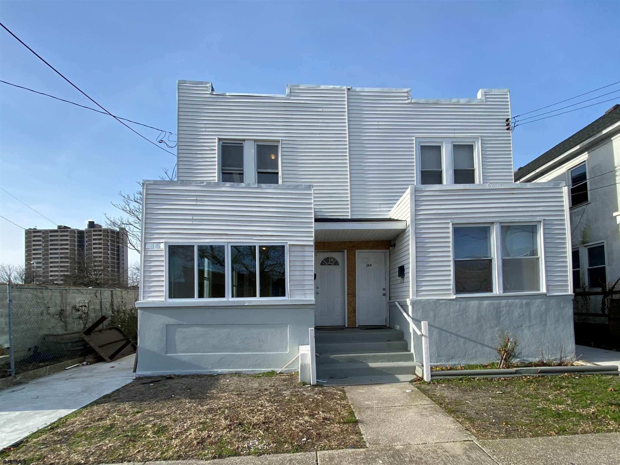 Totally renovated two-story home! Freshly painted and new laminate flooring throughout! NEW HVAC SYS
