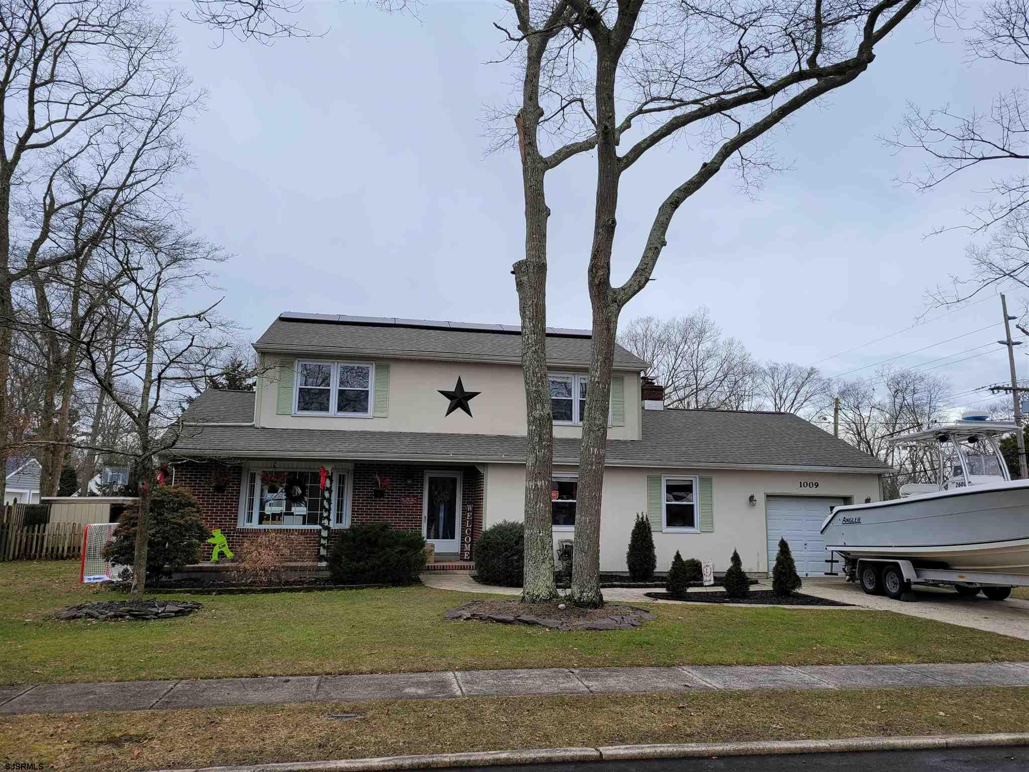 Located in the Lovely Absecon Estates.  This Colonial Home is Situate on a Corner with a Fenced in Y