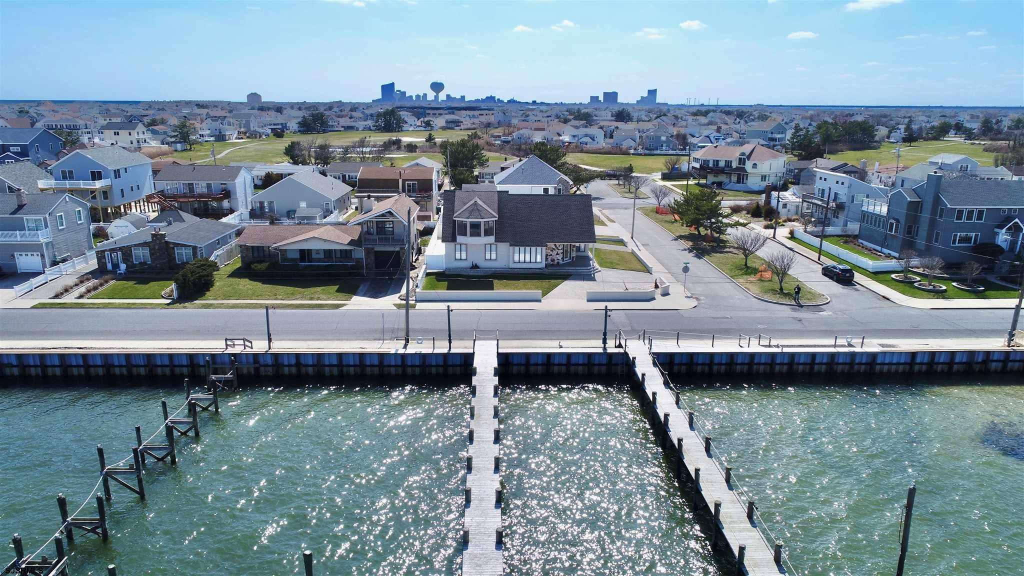 You CAN have it all!! Boater & beach lover? No problem! Dock with 4 boat slips & walking distance to