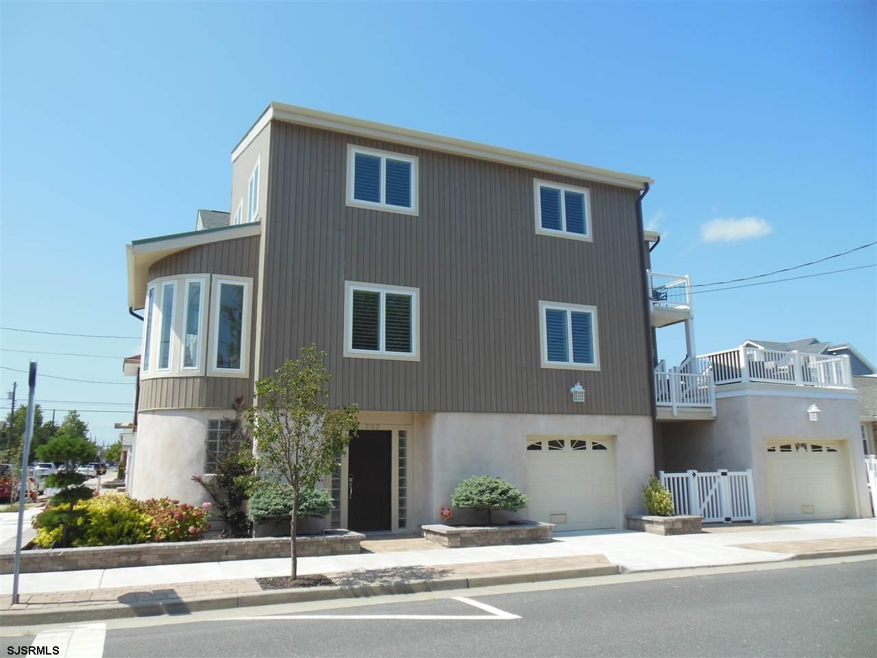 OCTOBER 12 - NOVEMBER 15, 2021. Enjoy beautiful sunsets from this 3 BR, 2.5 Bath home. Built in 2015, this newer home has it all - an open layout, beautiful kitchen and bathrooms, and a two car garage. Great for entertaining, two decks with views of the bay and a game room with ping pong table.  For music lovers there is also a SONOS sound system that can play 3 channels in different areas of the house.  Beach chairs, beach tags and basic cable with wifi included in the rent.  Walking distance to the boardwalk.