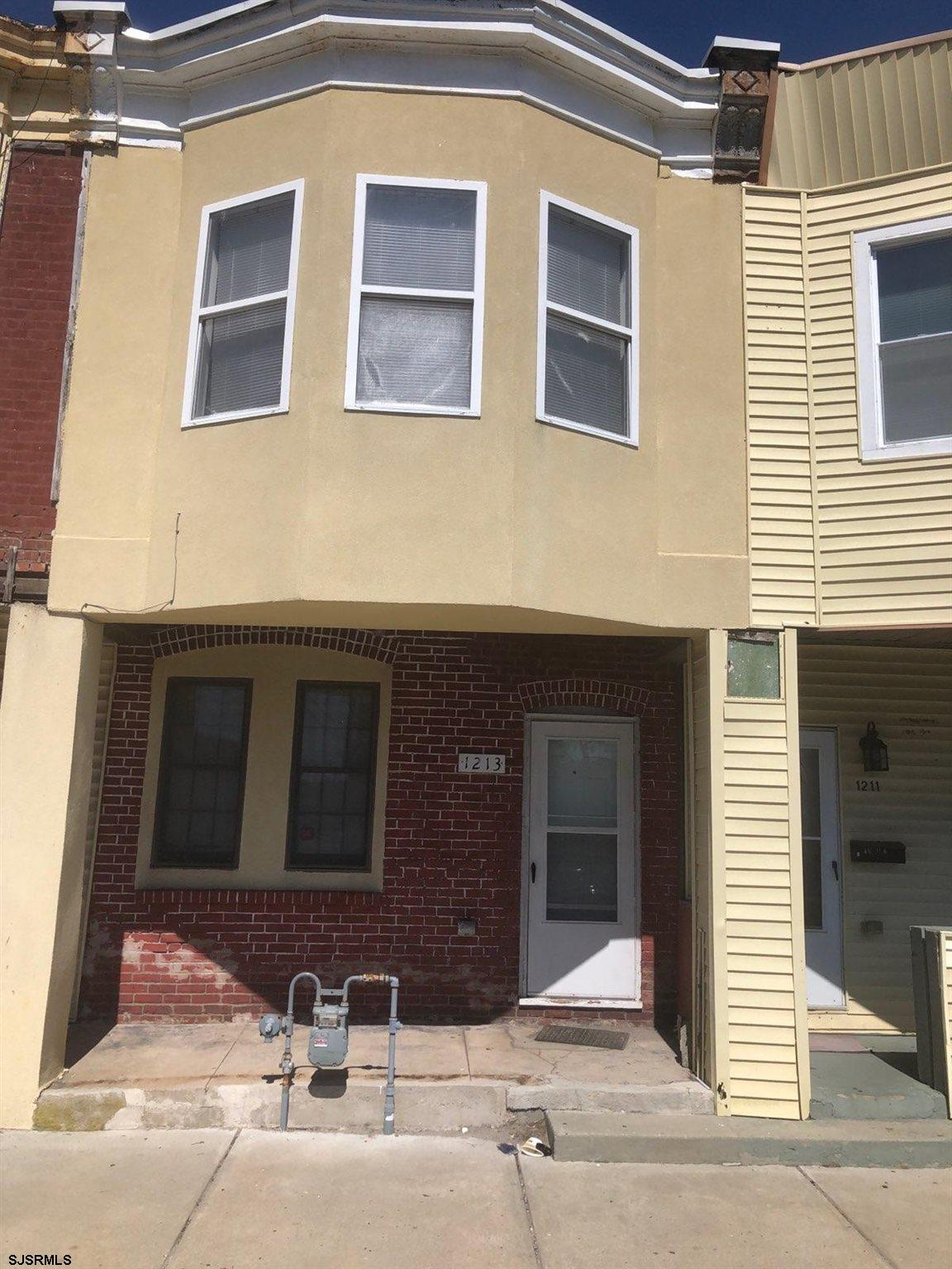 Main street facing Row Home. Close to ALL casino's and expressway. Selling as-is. Tenant occupied. 2