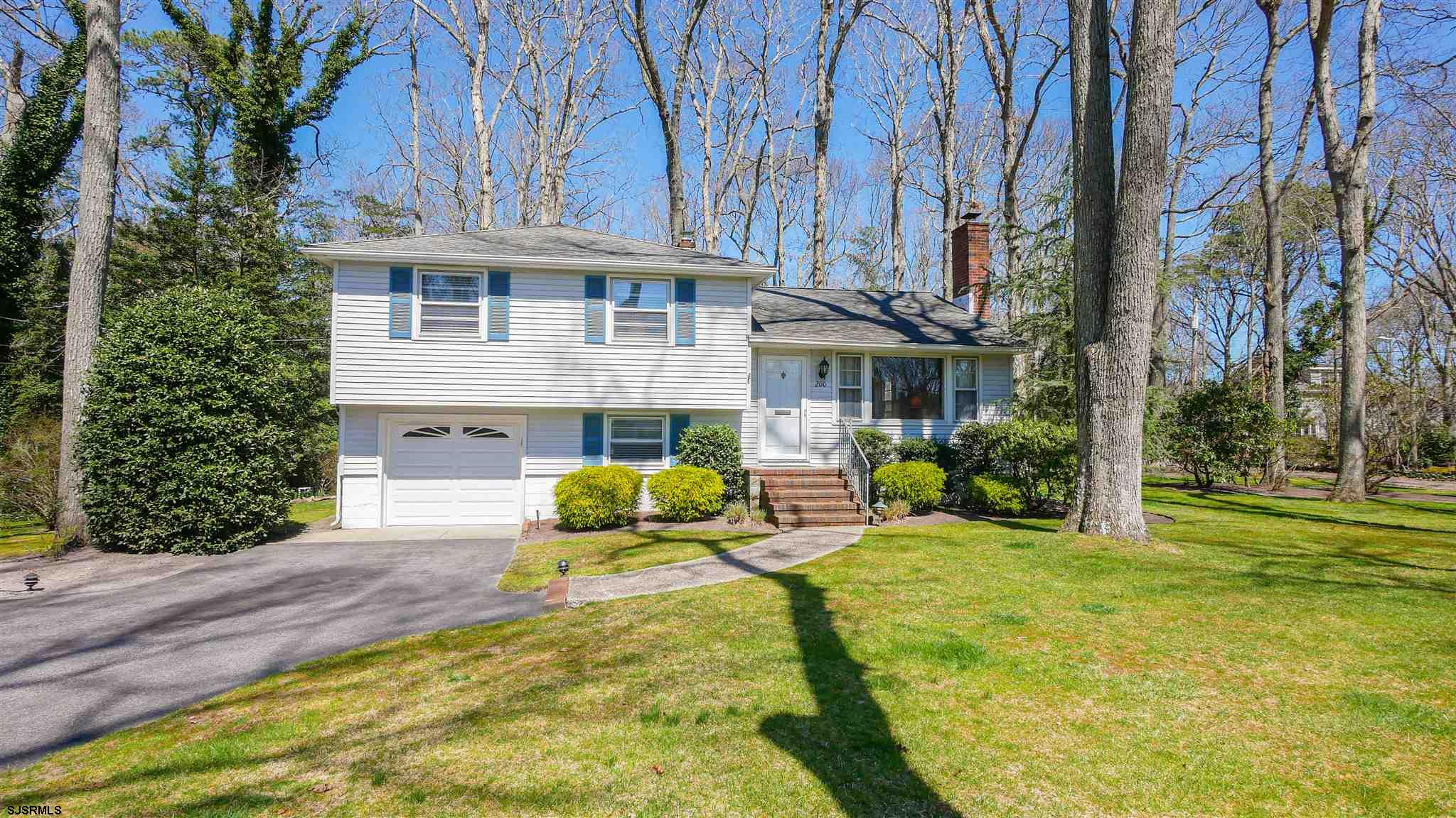 Peaceful and private setting on over one half an acre. This split level 3 bedroom, 1.5 bath home has