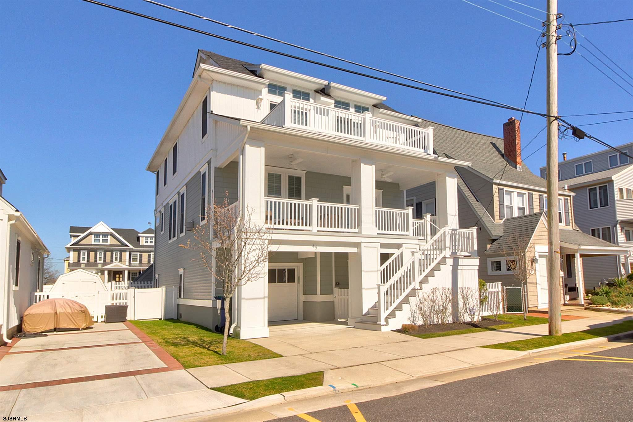 GORGEOUS single family home with BAY VIEWS! Relax and enjoy the view on your large front porch and 2