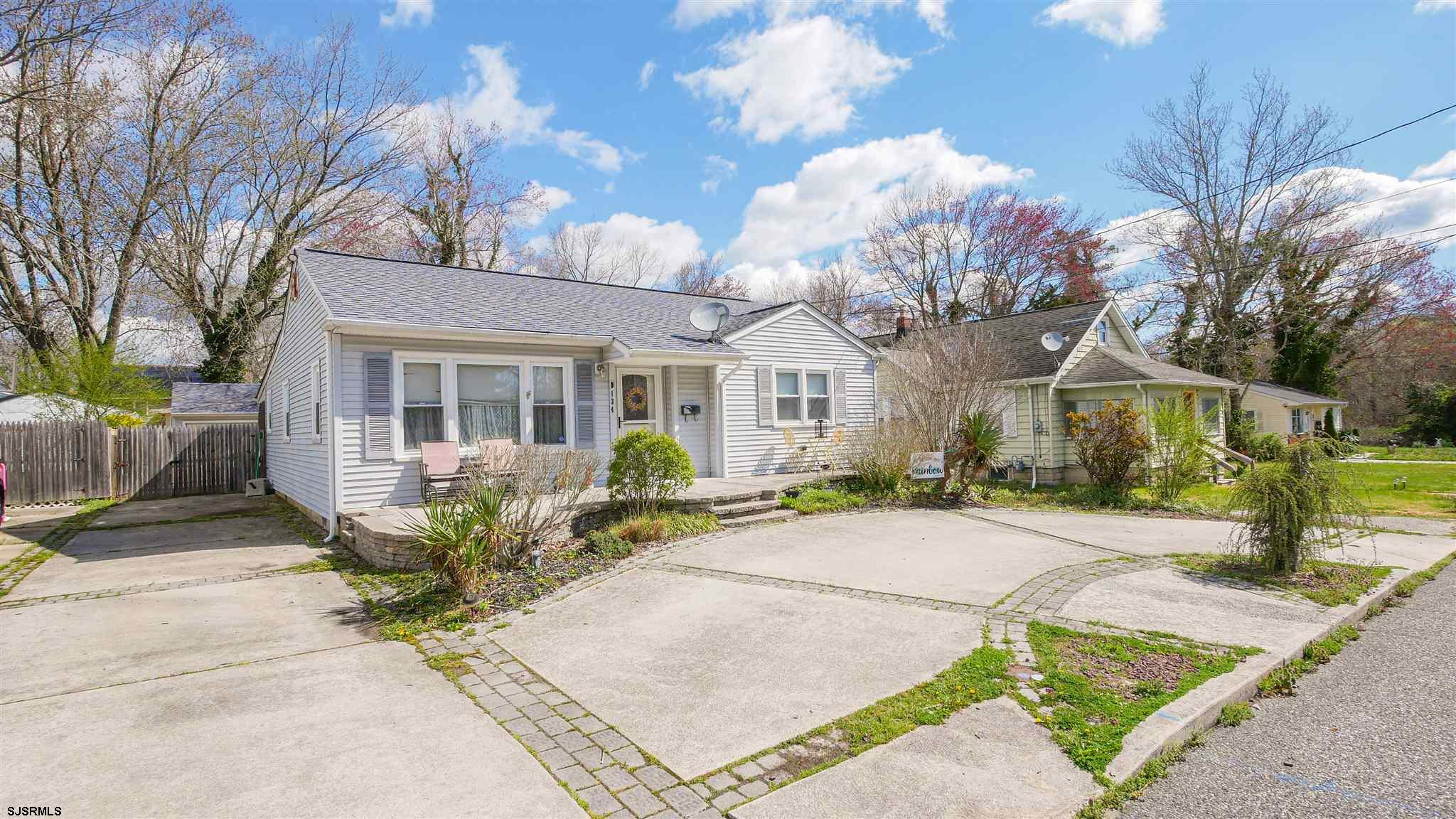 Beautiful ranch home located on a family friendly street. Featuring a U shaped driveway that offers