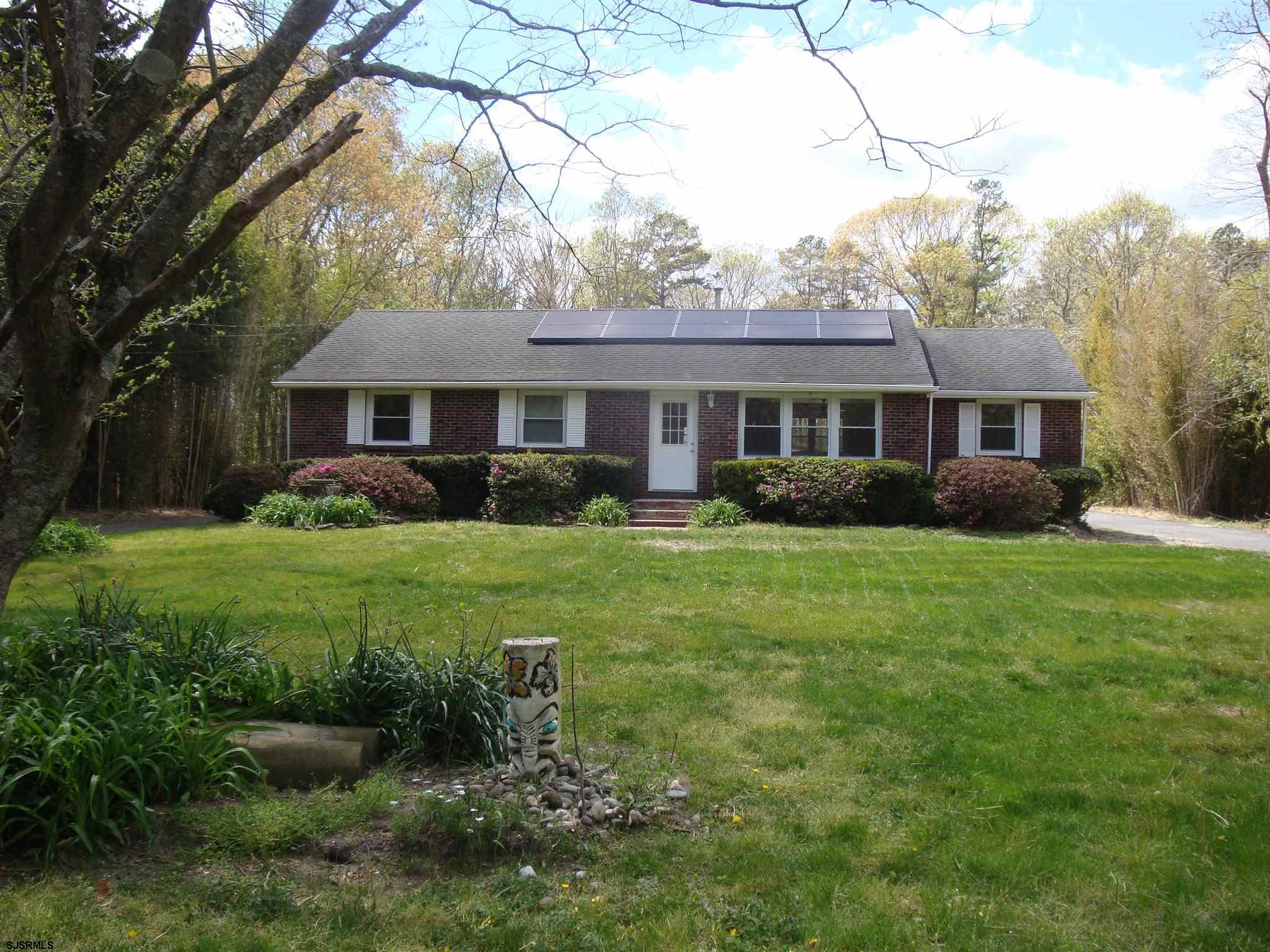OPPORTUNITY KNOCKS to own this lovely Brick ranch home on over 4 acres. Four bedrooms and two full baths. Master bedroom with new carpet and walk-in closet. Master Bath fully remodeled with tile floors, new vanity, deep soaking tub. Home has been freshly painted throughout. Original hardwood floors throughout as well. Full finished basement for fun and entertaining. New water treatment system installed 2020. BONUS 40x40 Polebarn insulated and heated can accommodate 6-8 cars and plenty of storage. Selling As-Is but definitely Move-In ready! Come view this one Today!