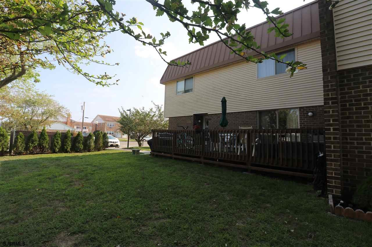 Great end unit 4BR, 2.5BA with large deck! Very well maintained throughout, updated kitchen, hardwoo