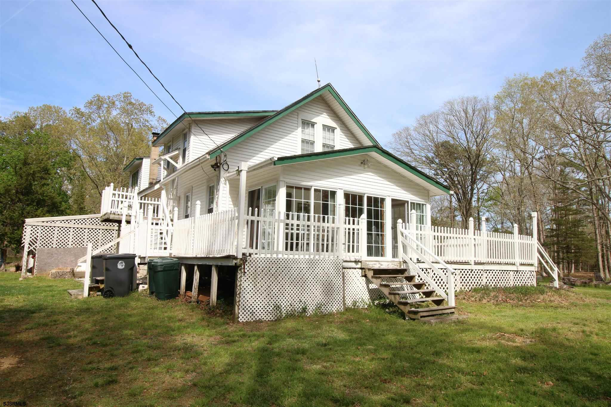 FANTASTIC LOCATION IN LAURELDALE! ALMOST TEN ACRES! 2 STORY HOME CURRENTLY USED AS A DUPLEX WAITING