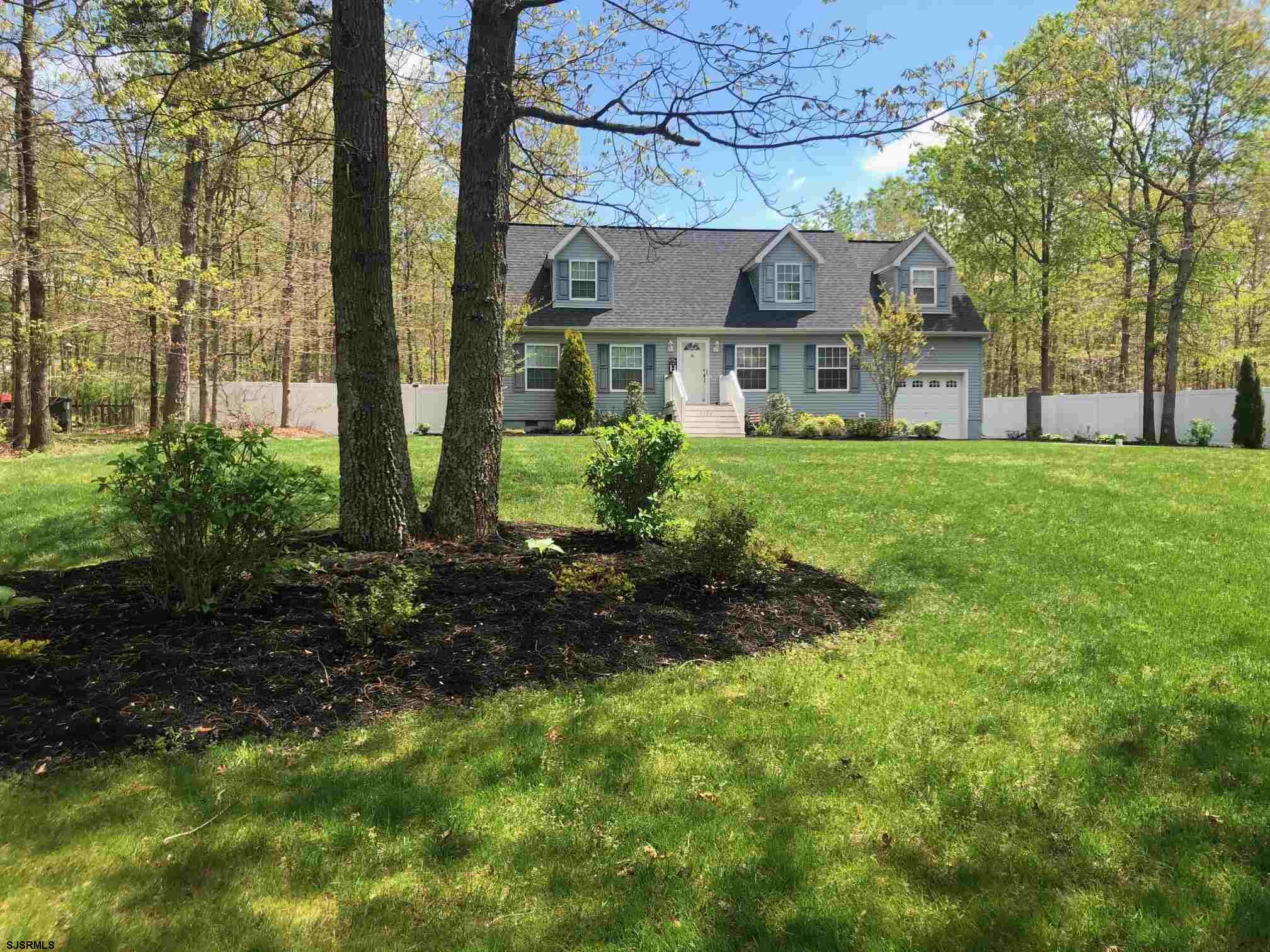 STORYBOOK CAPE COD Nestled on Beautifully Landscaped 1.17 Acres ! 4 Bedrooms 2 Full Baths Immaculate