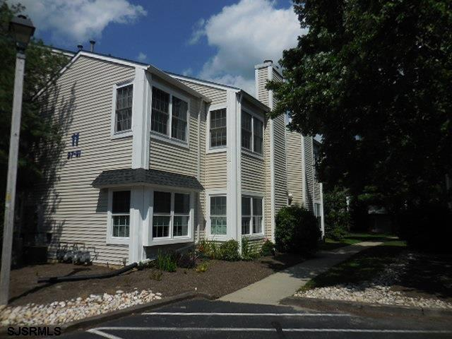 Second floor unit, FOX CHASE. Living room w/cathedral ceiling, corner fireplace, all appliances. Enj