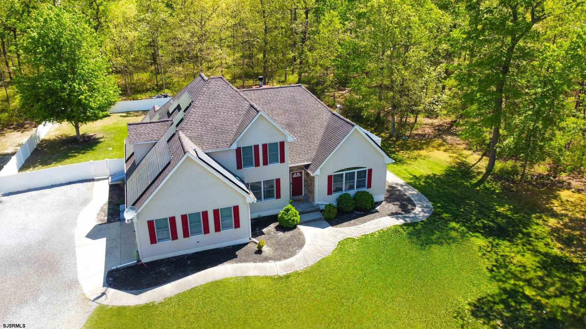 This beautifully maintained, 5 bedroom, 4.5 bathroom home, is located in the coveted area of Laureldale, Mays Landing. This home sits on a cul-de-sac with over 4 acres of land! Surrounded by beautiful landscapes, this serene location is only steps away from captivating nature trails, encompassed by the renowned NJ Pinelands. The fenced in yard makes it perfect for families with children and pets, and the in-ground pool makes it ideal for entertaining. This energy efficient home also comes fully equipped with solar panels, attached two car garage, full unfinished basement, and complete irrigation system! Although this home is secluded in what feels like its own personal retreat, it is only minutes from all major highways, Hamilton Mall, shop