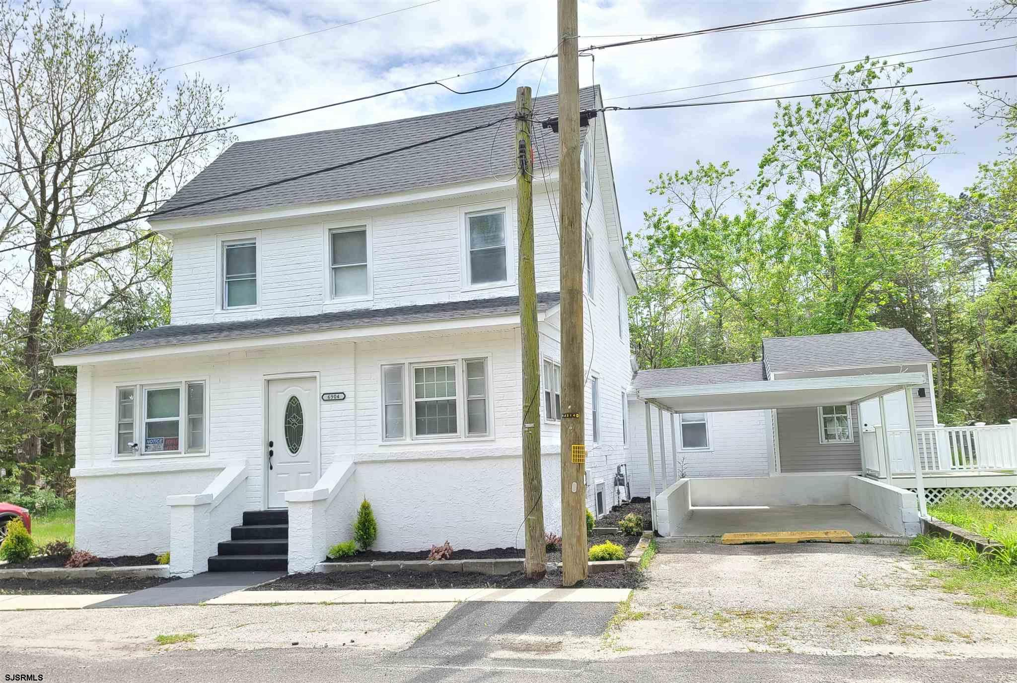 Completely renovated home features new flooring throughout, new kitchen, new appliances. 9 spacious