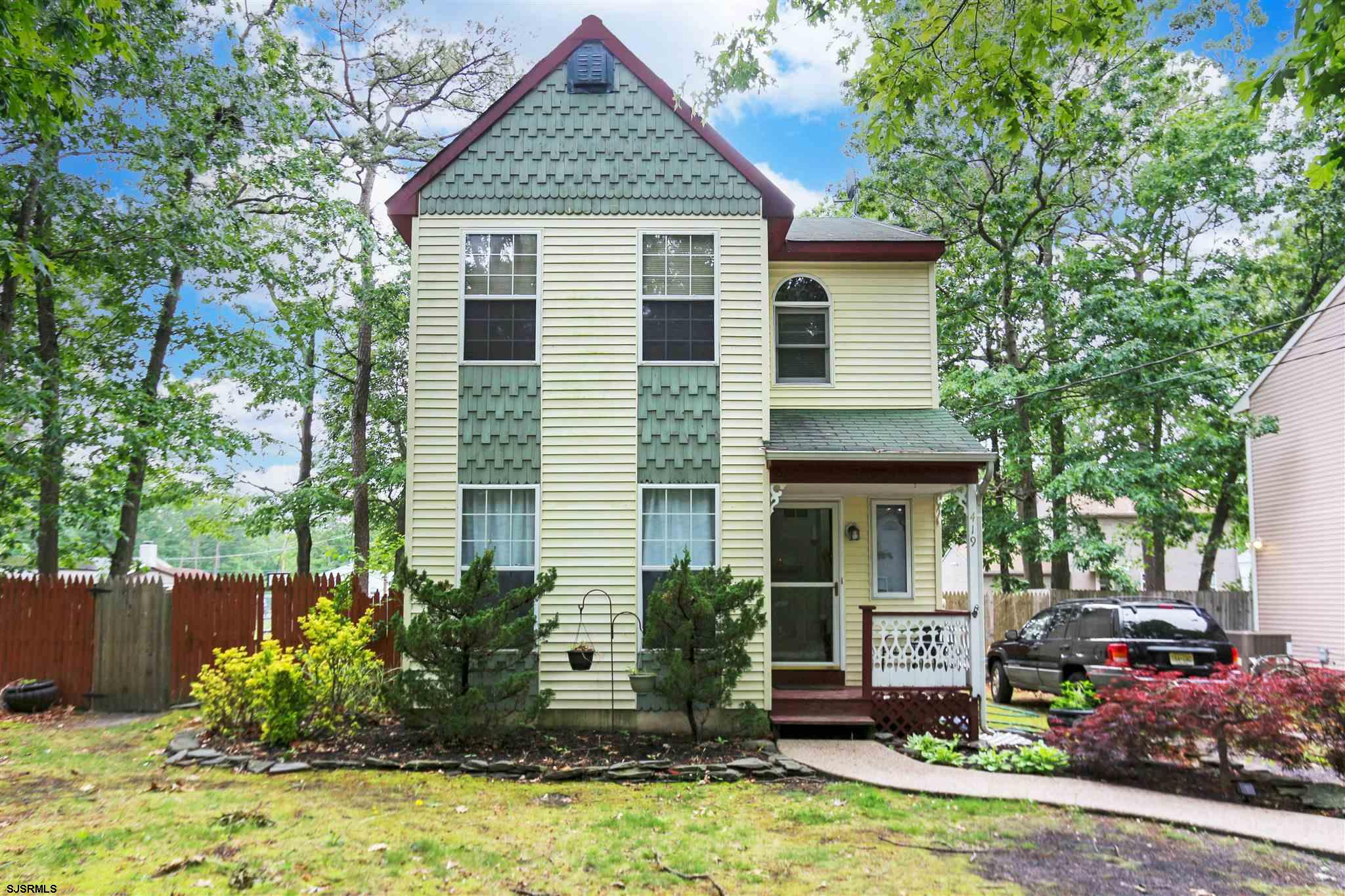 This beautiful 2 story single family home features 3 spacious bedrooms, 1.5 baths, formal living and