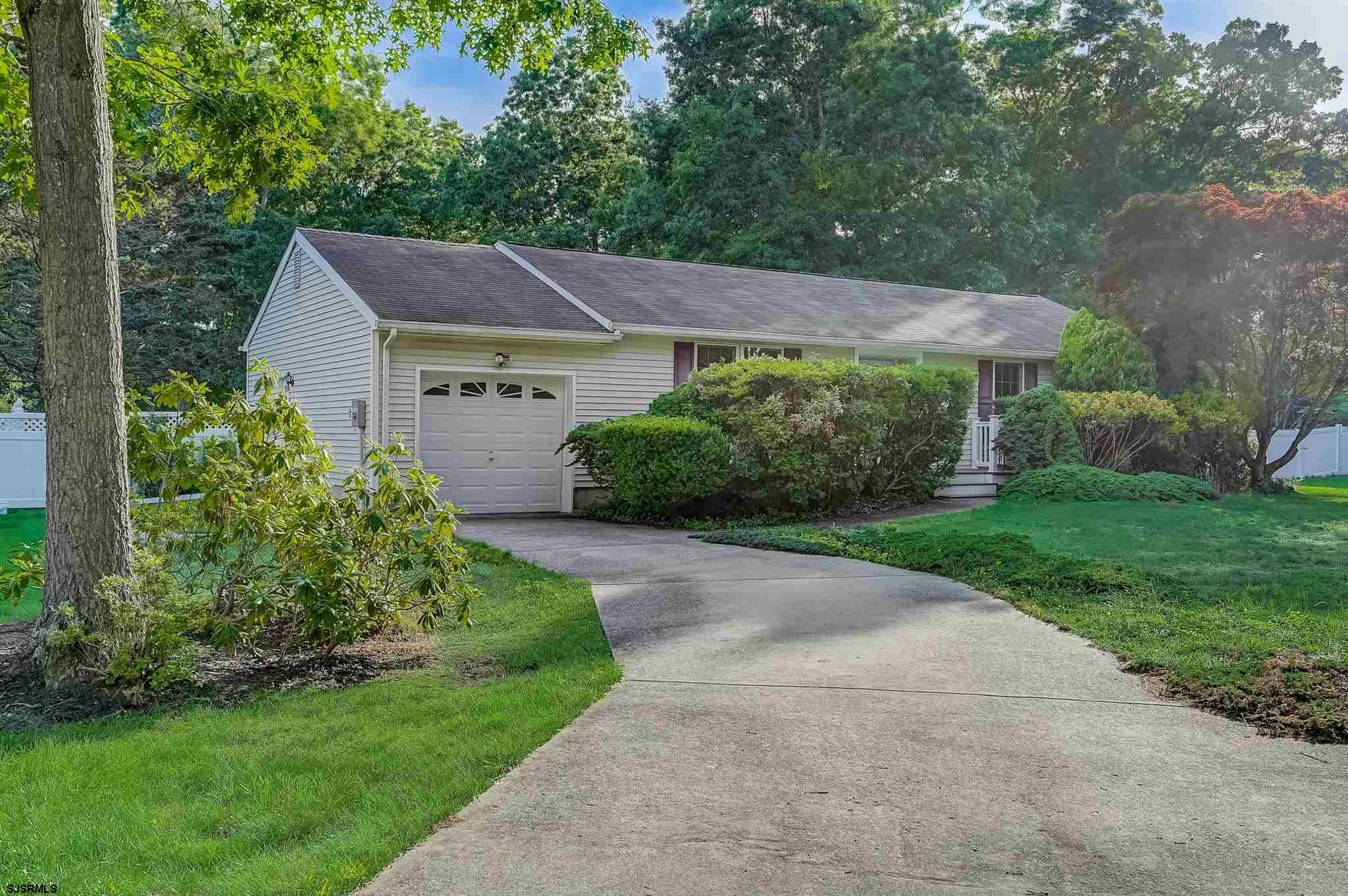 This Ranch style home features a magnificent enclosed porch/family room with 21 tilt-in windows over