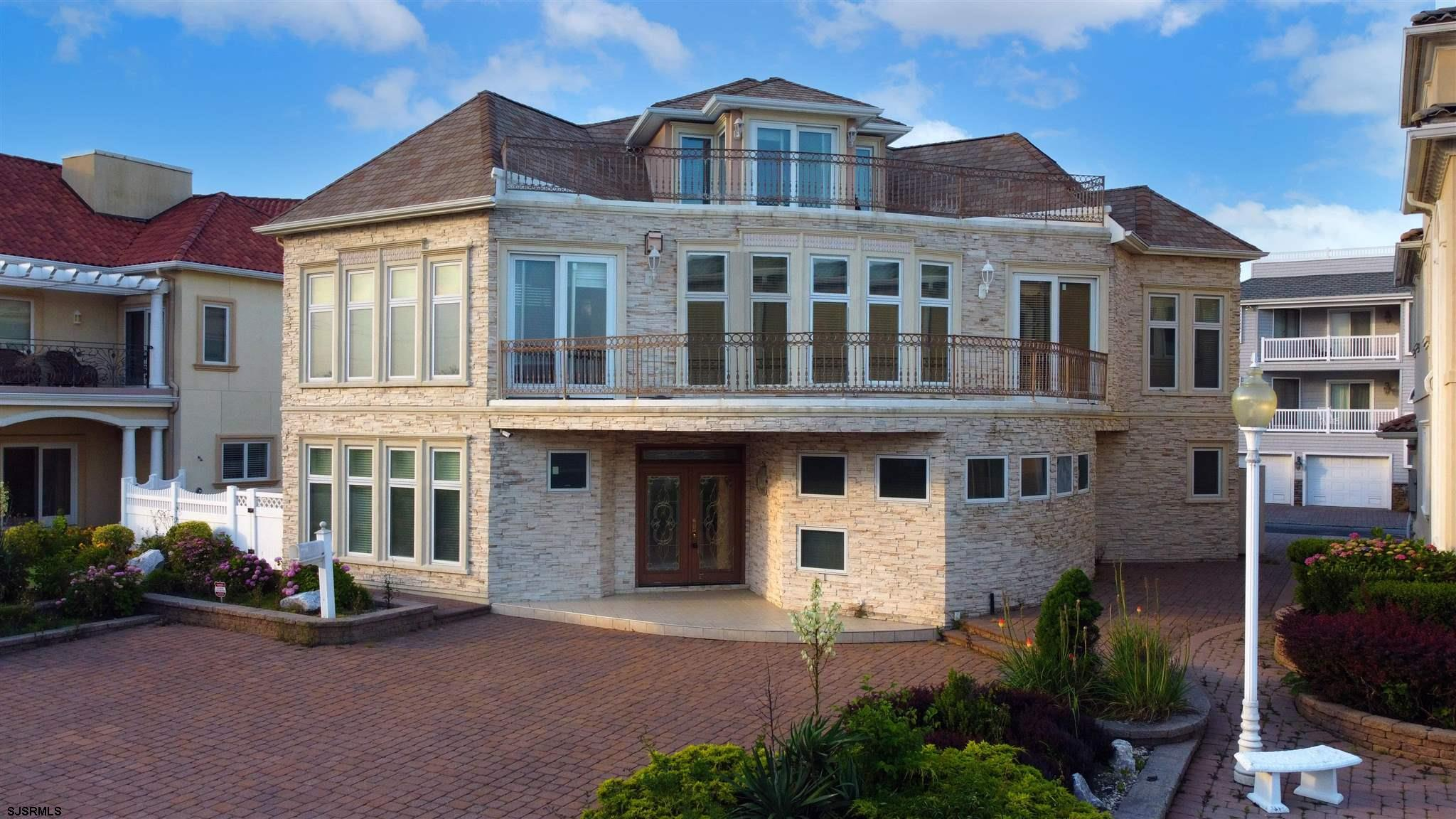 Breathtaking Ocean Views from this Enchanting 5 BR 4 Bath Masterpiece Located just one Home in from