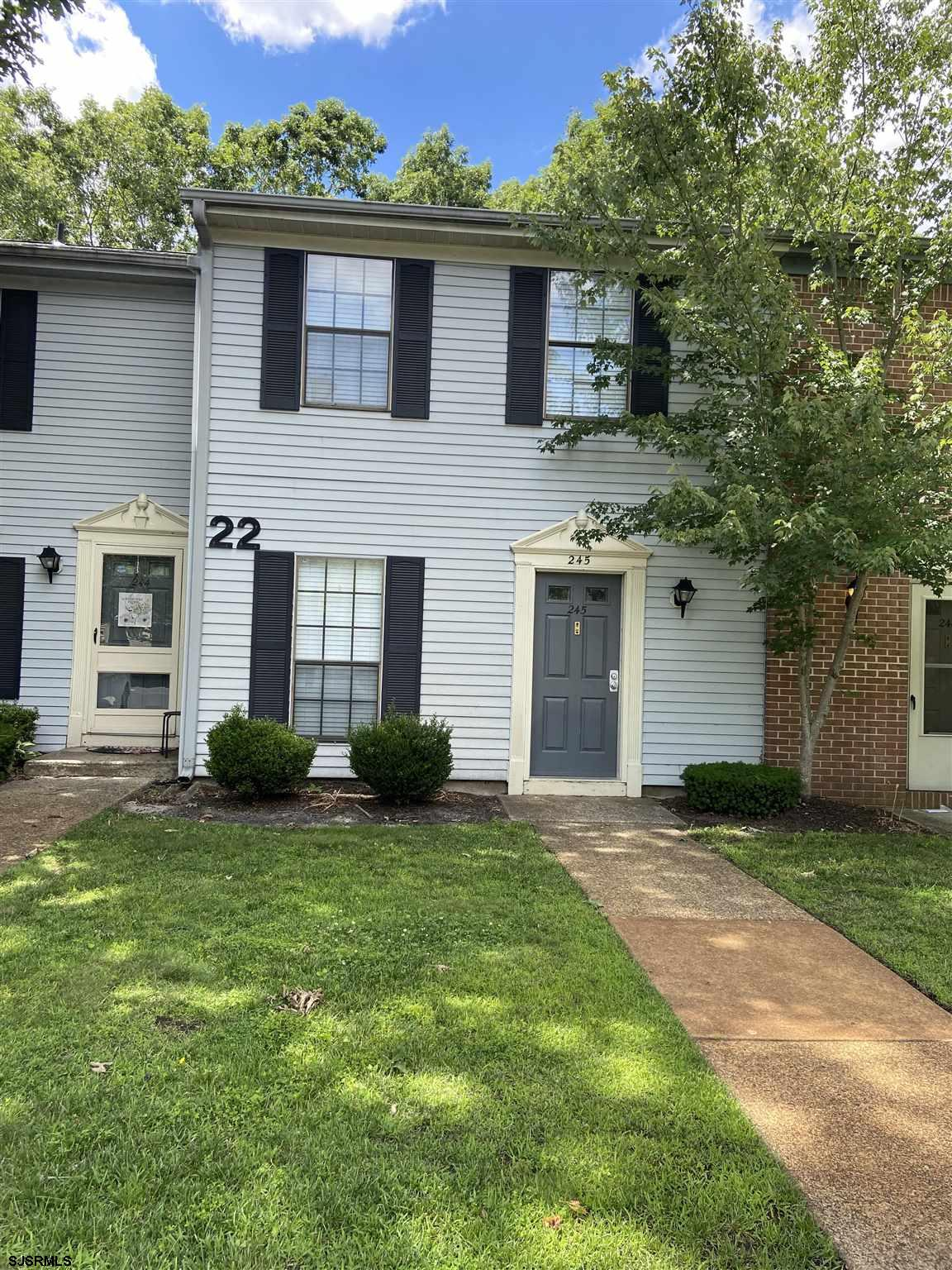 """Don't wait to show this updated 2 BD 2.5 BA townhome located in """"The Woods"""" off Great Creek Road. Th"""