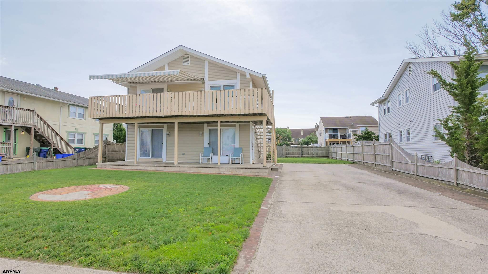 Beautiful 1ST floor 3 bedroom 1.5 Bath Condo with huge Front and Back Yard, Large front Porch and of