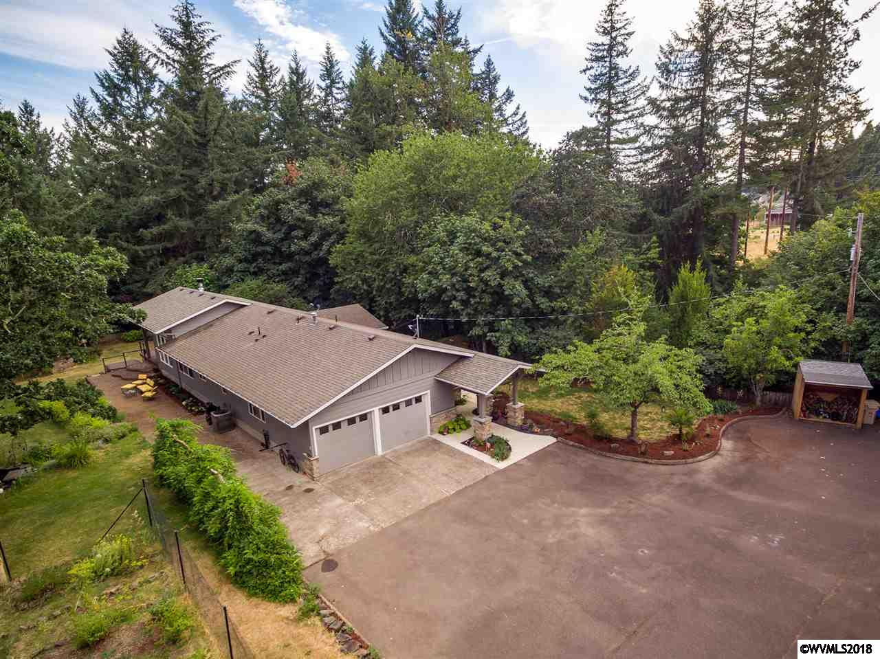 Price reduced! Complete 2016 remodel by Sierra Construction, exquisite & luxurious home is one of a kind. Set down a private gated drive and on over 3 acres with edge-of-the-world views of Willamette Valley & mountain ranges; you're surrounded by nature. Hdwd floors, vaulted ceilings, stone fp, picture windows in living & dining rms. Custom cabinets, granite counters, SSA and island in kitchen, custom cabinets, granite counters in baths. Office may be 3rd BR. Covered deck, hot tub, koi pond, RV pkg, sheds