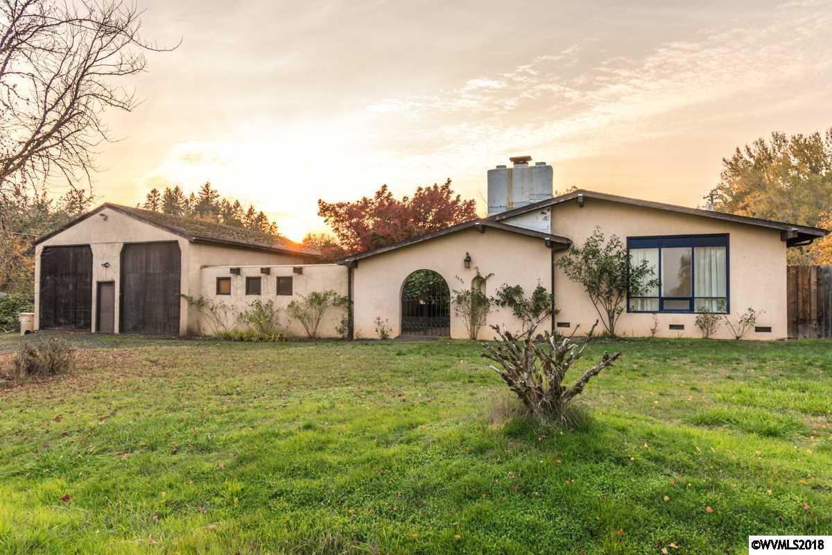 Come see this great stucco home in highly desirable area of Corvallis. This home has a separate 30x40 shop built to store RV's & Boats. Gorgeous mountain views. This is a As-Is sale with a bit of elbow grease this home can shine.