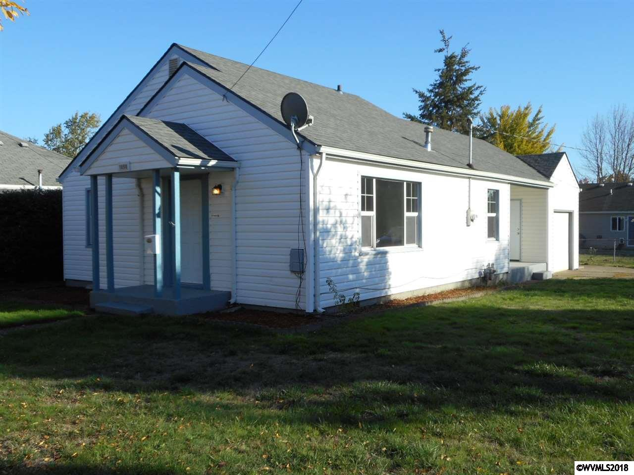 Welcome Home! 2BR/1BA/978SF on .11 acre corner lot in great SW neighborhood, just minutes to everything! Many updates including new roof/paint/fixtures/flooring, remodeled kitchen w/new appliances, remodeled bath & refinished HW floors. Nice sized rooms w/an easy flowing floor plan, GFA & huge inside utility/mudroom w/ample storage. Outside boasts easy maintenance vinyl siding & windows, UGS, 2 cvd porches & partially fenced yard w/RV pad & room for your toys! Seller is licensed Real Estate Broker in OR.