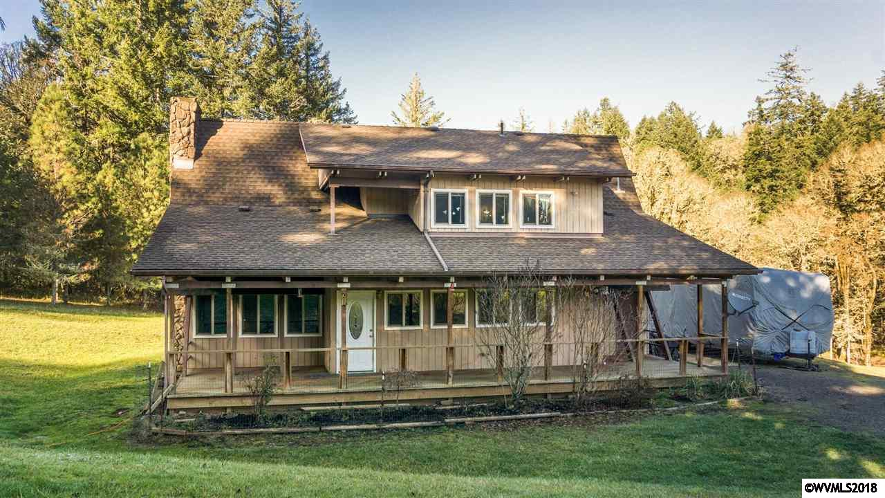 Beautiful 3.5 peaceful private acres in Mary's River Estates. 3 Bedroom home that needs some work. Perfect for 4H projects. A-frame style, new roof, vinyl windows & new deck, with dated interior. Priced to sell.