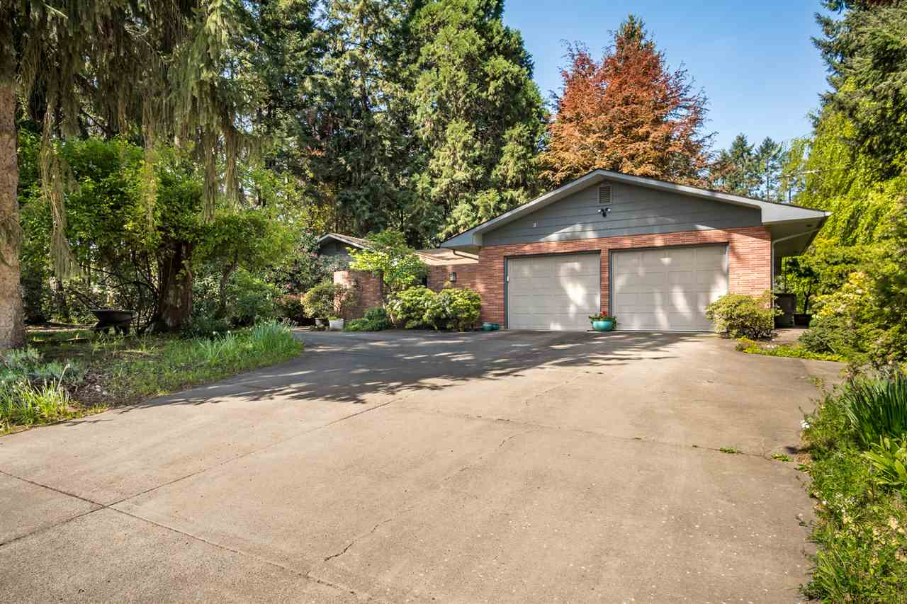 Solid one-level home on two lots for 2+ acres on private, dead end lane. Pastoral views just minutes from downtown & Hwy 20 to Corvallis. Lovely entry courtyard w/water feature, large living rm w/big picture windows. Kitchen with SSA, double ovens, breakfast nook overlooking large private backyard. Family room w/gas fireplace & slider to covered patio. Spacious master suite. Separate wing w/two more bedrooms, guest bath. Laundry room w/sink, 1/2 bath. Garage w/tons of storage. RV parking. NO drive-bys.