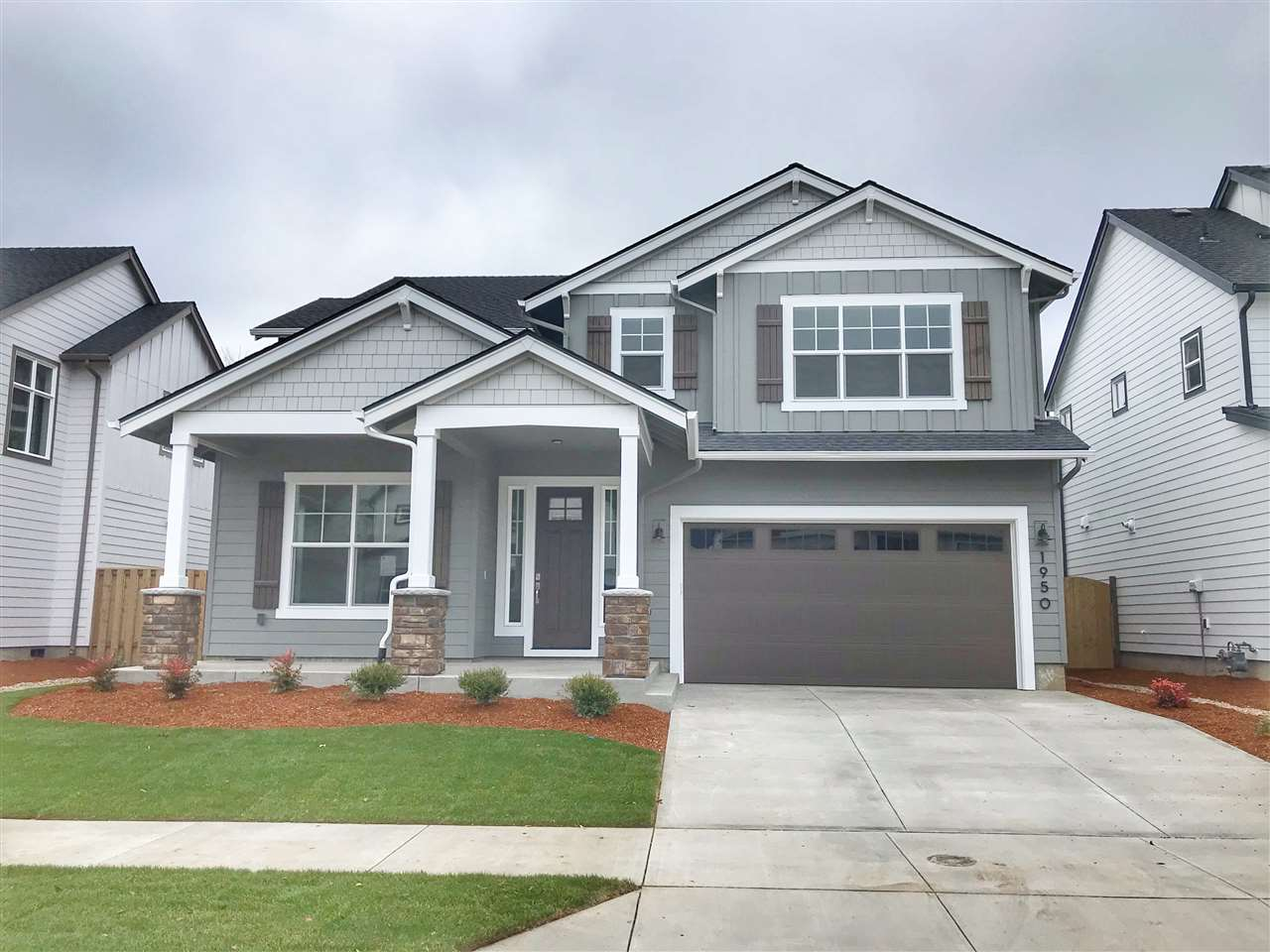 """Brand New Construction by Legend Homes & beautiful new Corvallis neighborhood. Move-in ready today. The """"Moreland"""". Desirable floorplan inc. spacious open flrplan, gracious kitchen with large pantry & dining rm, 4 bedrooms with a main floor guest suite/den & bonus/media room. The gracious MBR suite incl. freestanding soaking tub, tiled shower, huge closet and more. Beautiful and spacious for sure. Many model homes open Sat-Sun 11-3. Backyard landscaping & select privacy window coverings included."""