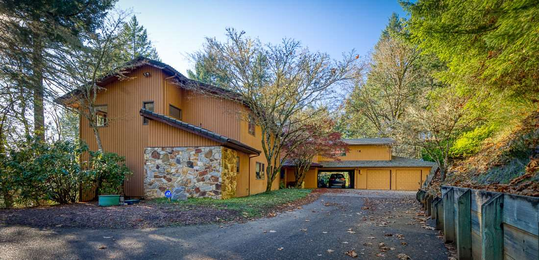 Have your cake and eat it, too! Imagine yourself surrounded by hundreds of acres of McDonald Forestland and hiking trails, while only being minutes from Good Sam Hospital, HP and downtown Corvallis. Inviting and warm floorpan allow for relaxing evenings around the wood burning fire place in the great room, or an all-out pool party any time of the year! ADA Accessible/Multigeneration Living.