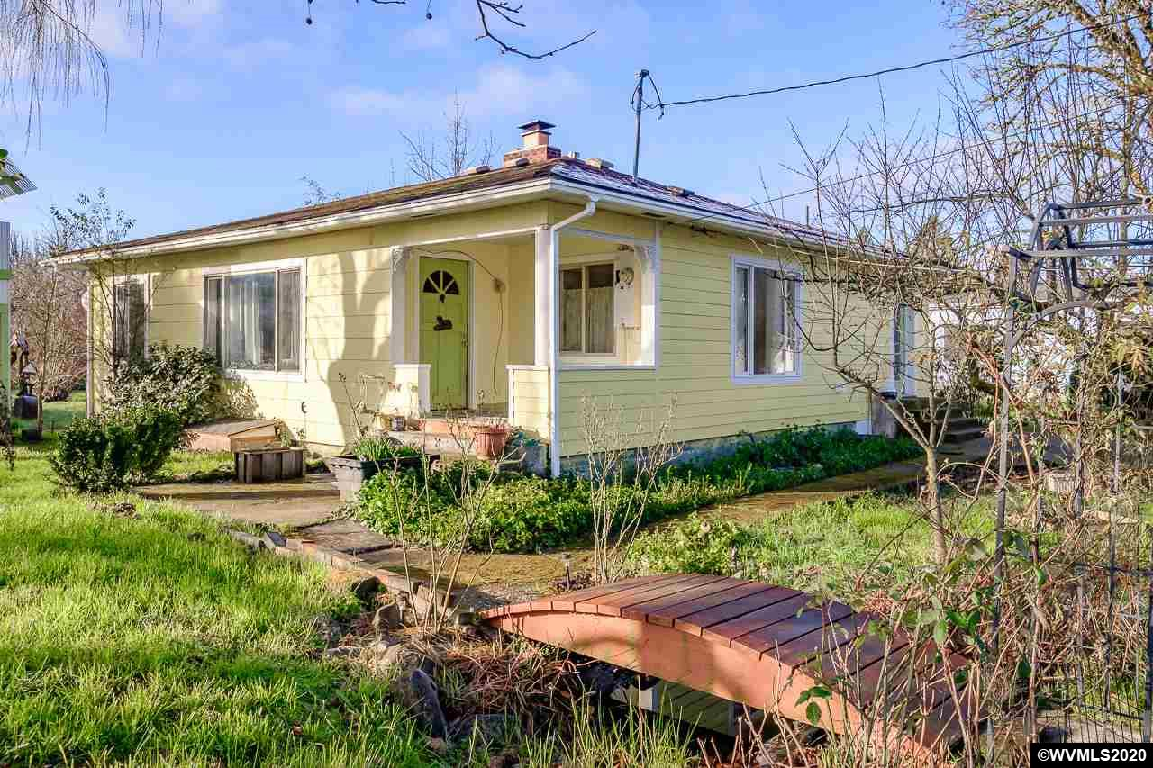 Good sized 2 bedroom 1 bath home ready for you to enjoy! Great natural light and cozy vibe throughout. Great side yards ready for planting gardens. Playhouse would be fun to make look the same as the main house. Excited to see the new homeowners make this one their own.