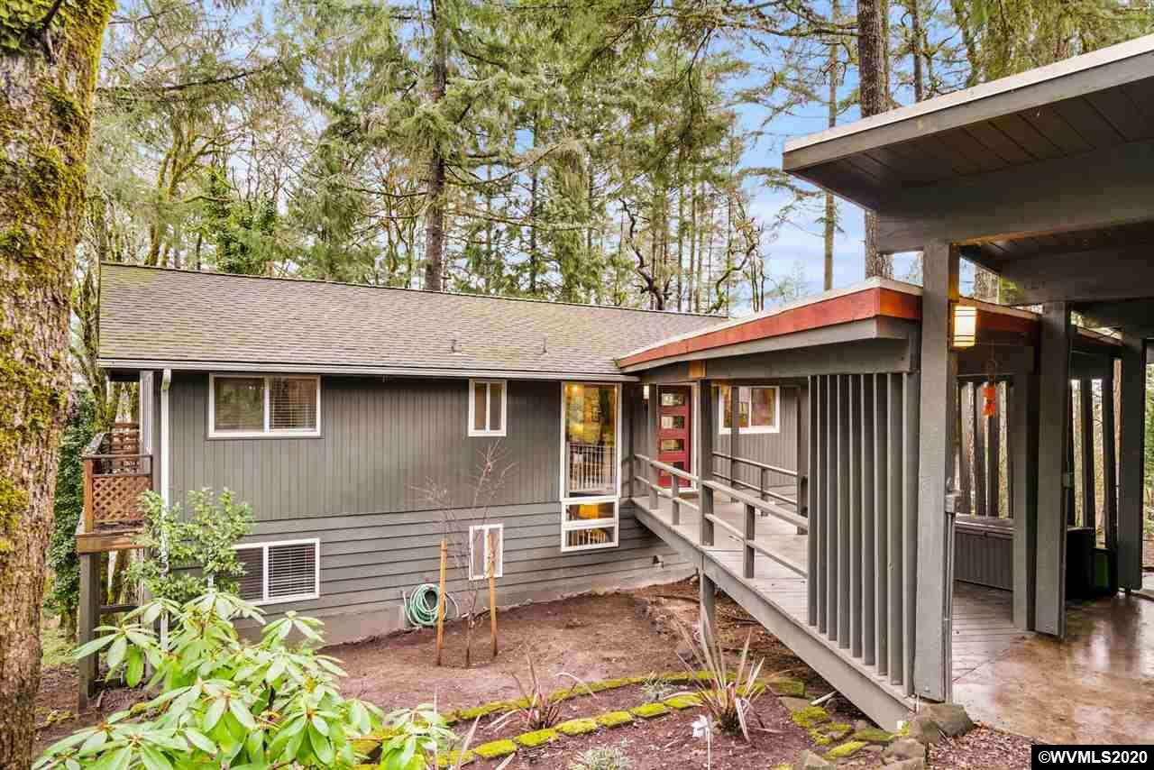 This wonderfully-updated, contemporary home sits in a beautiful forested setting in the Skyline West area of NW Corvallis. It features lovely wood floors, a gorgeous kitchen with a gas range, and huge decks that allow you to enjoy a peaceful and quiet sanctuary from a busy world. Relax knowing that the big things, like a new roof, windows, and doors are newer. Plus the open plan of the home allows for comfortable, spacious living, all settled on .38 Acres.
