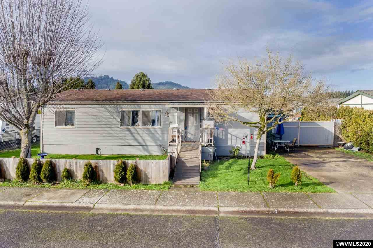 Great entertaining home inside and out. Wonderfully open floor plan in this 3bd, 2ba MFG home with new roof, siding, flooring and ADA toilets. Beautiful deck with hot tub that is covered.  Garden oasis behind the 24x36 partially insulated garage.