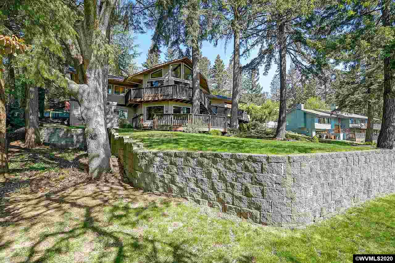 NW living at its best! Set among the trees w/ panoramic South facing valley views. Expansive upper/lower decks perfect for entertaining. Dream kitchen with open shelving, granite counters, SS appliances, family rm area with gas fireplace. Vaulted great room w/fireplace. Extensively updated master bath with soaking tub/glass block shower, Basement w/ separate entrance, large basement bonus rm, 5 bed, 3 full bath, 2 half. Possible dual living. Covered patio, outdoor living. Oversized Garage/Wkshop, NEW Roof.